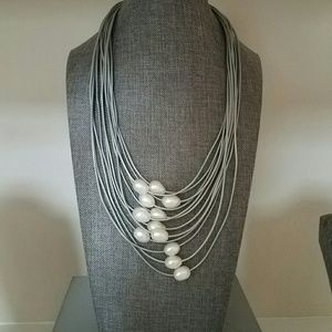 Leather strands with pearls